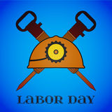 May 1st. Labor Day. Crossed Jackhammers and Helmet. May 1st. Labor Day background with two crossed jackhammers and helmet over blue . Poster, greeting card or Royalty Free Stock Photography