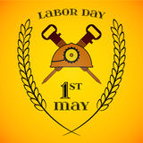 May 1st. Labor Day. crossed jackhammers and helmet Stock Image