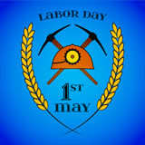 May 1st. Labor Day. Crossed Pickaxes and Helmet. May 1st. Labor Day background with two crossed pickaxes and helmet over blue . Poster, greeting card or brochure Stock Photos