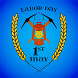 May 1st. Labor Day. Crossed Pickaxes and Lantern. May 1st. Labor Day background with two crossed pickaxes and lantern over blue . Poster, greeting card or Royalty Free Stock Photos