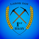 May 1st. Labor Day. Crossed pickaxes and wheat ears Royalty Free Stock Image