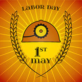 May 1st. Labor Day. Mine helmet and wheat ears. May Day. May 1st. Labor Day background with mine helmet and wheat ears over retro rays background. Poster Stock Photography
