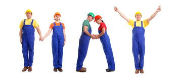 May staff. Group of young people wearing different color uniforms and hard hats forming May word - isolated on white background - calendar concept Stock Photos