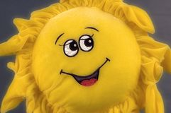 May the Sun shine... Fluffy toy sun. Stoff Sonne royalty free stock photo