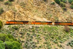 May 25, 2018 Tehachapi / CA / USA - Distinctive orange and yellow Burlington Northern Santa Fe (BNSF) engines travelling through stock photo
