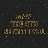 May the 4th be with you. Sci-fi yellow border letters on space background with stars.  Stock Photography