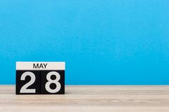 May 28th. Day 28 of month, calendar on blue background. Spring time, empty space for text.  Royalty Free Stock Photography