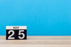 May 25th. Day 25 of month, calendar on blue background. Spring time, empty space for text.  Stock Photo