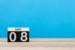 May 8th. Day 8 of month, calendar on blue background. Spring time, empty space for text. World Red Cross and red Stock Photo