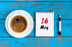 May 16th. Day 16 of month, tear-off calendar with morning coffee cup at work place background. Spring time, Top view Stock Photos