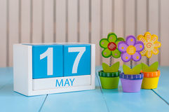 May 17th. Image of may 17 wooden color calendar on white background with flowers. Spring day, empty space for text Stock Image