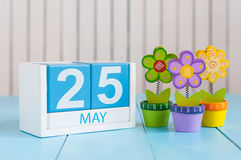 May 25th. Image of may 25 wooden color calendar on white background with flowers. Spring day, empty space for text Stock Photography
