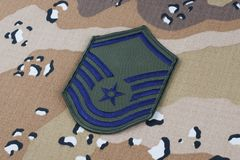 May 12, 2018. US AIR FORCE Master Sergeant rank patch on Desert Battle Dress Uniform background. May 12, 2018. US AIR FORCE Master Sergeant rank patch on Desert stock image