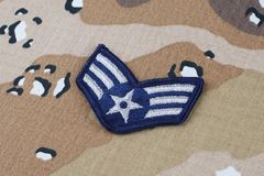 May 12, 2018. US AIR FORCE Senior Airman rank patch on Desert Battle Dress Uniform background. May 12, 2018. US AIR FORCE Senior Airman rank patch on Desert stock image