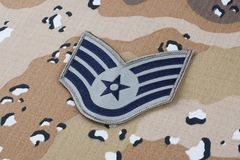 May 12, 2018. US AIR FORCE Staff Sergeant rank patch on Desert Battle Dress Uniform background. May 12, 2018. US AIR FORCE Staff Sergeant rank patch on Desert stock photos