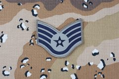 May 12, 2018. US AIR FORCE Staff Sergeant rank patch on desert camouflage uniform background. May 12, 2018. US AIR FORCE Staff Sergeant rank patch on desert royalty free stock images