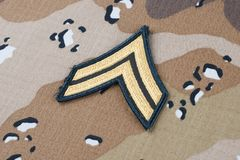 May 12, 2018. US ARMY Corporal rank patch on Desert Battle Dress Uniform background. May 12, 2018. US ARMY Corporal rank patch on Desert Battle Dress Uniform stock image