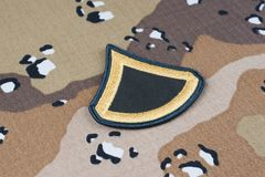 May 12, 2018. US ARMY Private First Class rank patch on Desert Battle Dress Uniform background stock photo