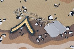 May 12, 2018. US ARMY Private rank patch and dog tags on Desert Battle Dress Uniform background. May 12, 2018. US ARMY Private rank patch and dog tags on Desert stock photos