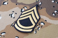 May 12, 2018. US ARMY Sergeant First Class rank patch on Desert Battle Dress Uniform background. May 12, 2018. US ARMY Sergeant First Class rank patch on Desert stock photos