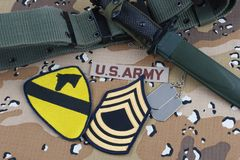 May 12, 2018. US ARMY 1st Cavalry Division patch bayonet and dog tags on desert camouflage uniform stock image
