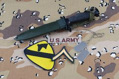 May 12, 2018. US ARMY 1st Cavalry Division patch bayonet and dog tags on desert camouflage uniform stock photography