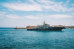 Huge yacht sailing into the old town of Valletta on Malta. May 1, 2018. Valletta, Malta. Huge yacht sailing into the old town of Valletta on Malta Royalty Free Stock Images