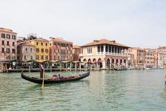 May 2017 Venice, Italy. Gondola  on the Grand Canal in front of  Rialto market Royalty Free Stock Photos