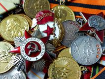 May 9 - Victory Day. Close-up orden of the `Great patriotic war`, sign of `Guards` against the background of combat medals royalty free stock photos