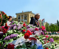 May 9. Victory Day. Laying flowers at the Monument of Glory. May 9. Victory Day. Holiday, Victory Day. May 9. Veterans with medals are on the streets of the city Royalty Free Stock Image