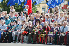 May 9. Victory Day. Older men, veterans of the war, sitting with medals and flowers Stock Image