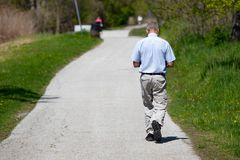 May 14 2019 Windsor Ontario Canada Street Photography Man Someone Anyone Somebody Anybody Walking Away Urban Park Trail. Exercise royalty free stock photos