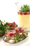 May wine with strawberries and woodruff Royalty Free Stock Photo