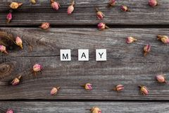 May word is made of bright wood cubes on a dark wooden background royalty free stock image