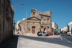 Malta and Gozo 2018. MAY 6, 2018 - XEWKIJA, GOZO ISLAND, MALTA: Maltese street view with traditional houses and a small church Royalty Free Stock Images