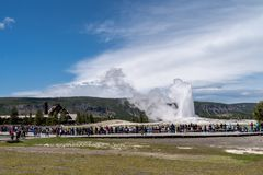 Yellowstone, Wyoming: Crowds of tourists and visit. Yellowstone, Wyoming: Crowds of unidentifiable tourists and visitors gather around the boardwalk to watch Old royalty free stock photography