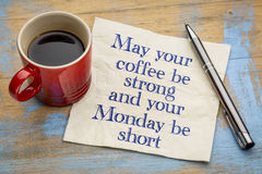 May your coffee be strong. And your Monday be short - handwriting on a napkin with a cup of espresso coffee Stock Photo