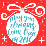 May your dreams come true in 2016. Hand drawn. Greeting card with Christmas tree decoration and lettering inside round shape. Vintage red, blue and white colors Stock Images