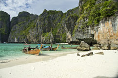 Maya Bay. Long tail boats sit in Maya Bay, Koh Phi Phi Ley, Thailand. The place where the movie the Beach was filmed Stock Photos