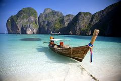 Maya Bay. A long tail boat sits in Maya Bay, Koh Phi Phi Ley, Thailand. The place where the movie the Beach was filmed Royalty Free Stock Photos