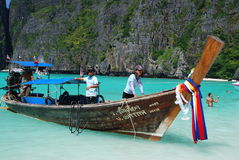 Maya Bay, Thailand: Crew on Long Boat Royalty Free Stock Images