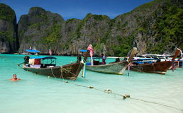 Maya Bay, Thailand: Long Boats at Anchor Stock Photography