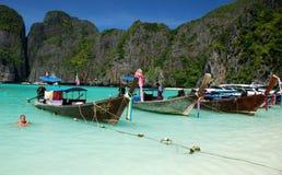 Maya Bay, Thailand: Long Boats at Anchor Stock Photography