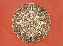 Maya calendar. On a red wall Stock Photos