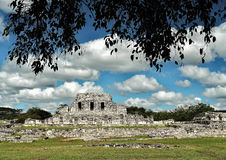 Maya_culture_23. An image of the building called `the 3 lintels` dificio located in the old Mayan city of Mayapan in Yucatan. Mexico, color, background of blue Royalty Free Stock Images
