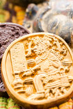 Maya glyphs. Gourmet Maya glyphs in dark chocolate covered with gold dusting Stock Photography