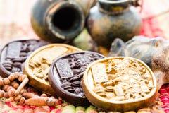 Maya glyphs. Gourmet Maya glyphs in dark chocolate covered with gold dusting Stock Photo