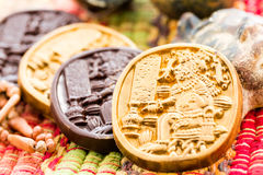 Maya glyphs. Gourmet Maya glyphs in dark chocolate covered with gold dusting Royalty Free Stock Images