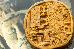 Maya glyphs. Gourmet Maya glyphs in dark chocolate covered with gold dusting Stock Images