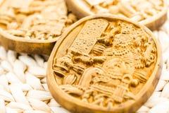 Maya glyphs. Gourmet Maya glyphs in dark chocolate covered with gold dusting Stock Image